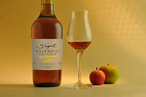 Calvados bottle with calvados glass and apple